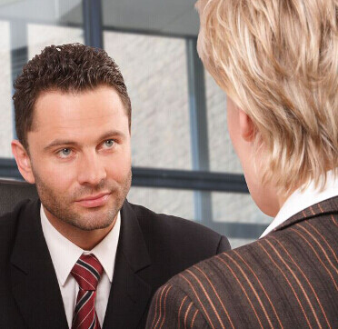 a salesperson listening carefully to a client